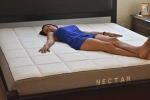 Rana laying on a Nectar Mattress