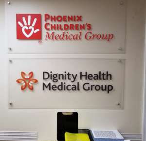 Phoenix Children's medical group and dignity health medical group signs in phoenix dream center