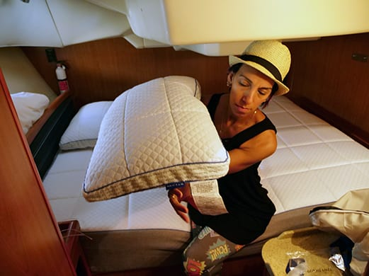 rana showing the nectar pillow on a nectar mattress inside a sailboat